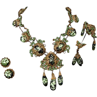 MIRIAM HASKELL Green Glass and Jadeite Cabochons in Antiqued Gilt Filigree Pendant Necklace, Pin, and Clip Earrings Set