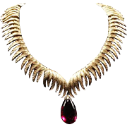 TRIFARI 'Alfred Philippe' Brushed Gold Feather Form Links Necklace with Ruby Red Jewel Pendant Drop