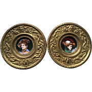 Pair Continental Porcelain Portrait Plaques in Brass Repousse Frame