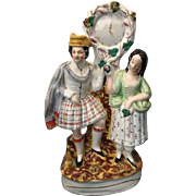 19th Century Staffordshire Flatback Figure of Scottish Couple with Clock Face