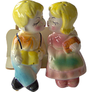 Vintage Kissing Couple on a Bench Salt and Pepper Shakers