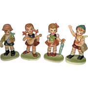 Four Adorable Children Figurines