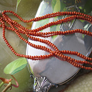 Natural Coral Three-strands Necklace and 14k Yellow Gold Clasp.