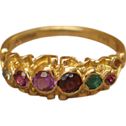 "Antique acrostic ring "" REGARD"" in ruby, emerald, garnet, amethyst, ruby, and diamond with 9ct gold."
