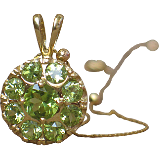 Peridot and 14k yellow gold pendant.