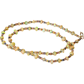 Natural opal bead and Fancy sapphire bead 14k gold necklace.  Artisan necklace.