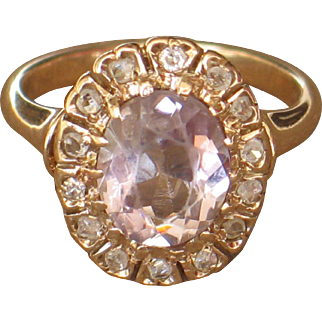 Antique rose gold ring with diamonds and topaz.