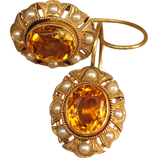 Antique earrings with natural seed pearls and topaz.  14k yellow gold.