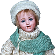Laughing Heubach Character with Glass Eyes #5636 in Victorian Winter Gear