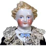 Exceptional Blond Dresden Gentleman China Doll with Molded blouse