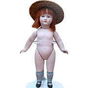 6.5 inch All Bisque Doll with Blue Socks