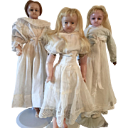 Three Poured Wax Dolls