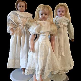 Three Poured Wax Dolls
