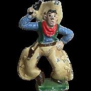 Wonderful Vintage Cast Iron Cowboy Paperweight or Bottle Opener