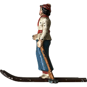 Charming 1940's Hubley Cast Iron Female Skier Paperweight Figurine