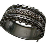 A Victorian Sterling Silver Hinged Bracelet. Circa 1885.