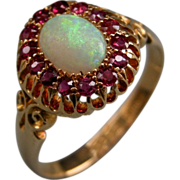 An Edwardian 18ct Gold Opal and Ruby Cluster Ring. Circa 1905.