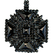 A Victorian Black Glass Maltese Cross. Circa 1875.