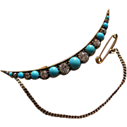 A Victorian 18ct Gold, Diamond and Turquoise set Cresent Brooch. Circa 1895.