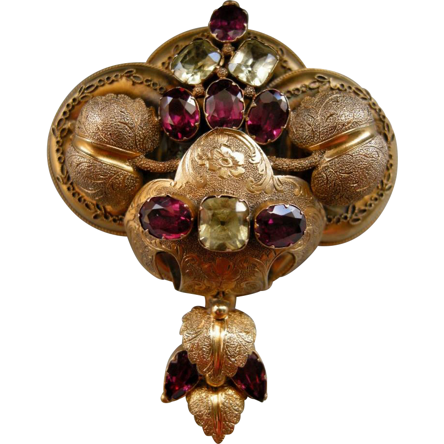 A Victorian 15ct Gold, Garnet and Chrysoberyl Brooch. Circa 1855.