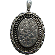 A Victorian Sterling Silver Locket. Circa 1881.
