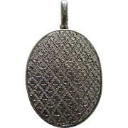 A Victorian Sterling Silver Locket. Circa 1880.