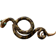 A Georgian Snake Mourning Brooch. Circa 1836.