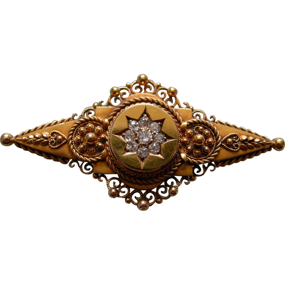 A Victorian 15ct Gold and Diamond Set Brooch. Circa 1897.