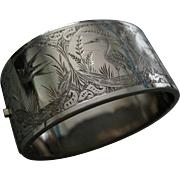 A Victorian Front and Back Sterling Silver Hinged Bracelet. Circa 1885.