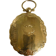 A Victorian 15ct Gold Back and Front Locket. Circa 1860.