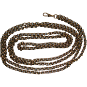 A Victorian 9 ct Gold Long Guard Chain. Circa 1890.