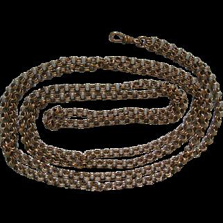 A Victorian 9 ct Gold Long Guard Chain. Circa 1890.
