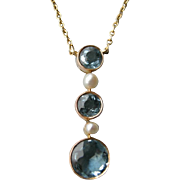 An Edwardian 15 ct Gold, Aquamarine and Seed Pearl Pendant. Circa 1905.