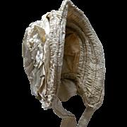 A Victorian Caleche Silk Bonnet. Circa 1850.