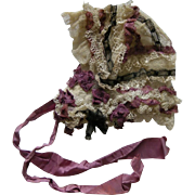 A Victorian Silk Trimmed Bonnet. Circa 1850.
