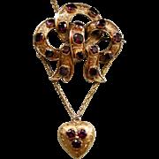 A Victorian 15ct Gold and Garnet Set Bow & Heart Festoon Brooch. Circa 1845