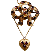 A Victorian 15ct Gold and Garnet Set Bow & Heart Festoon Brooch. Circa 1845