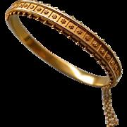 A Victorian 15 ct Gold Hinged Bracelet. Circa 1880