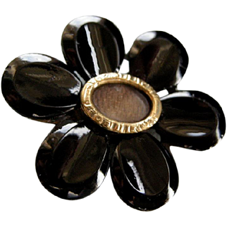 A Georgian Black Glass Flower Head Mourning Brooch. Circa 1825.