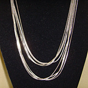 Multi-Stand Silver-Tone Serpentine Fluid Necklace