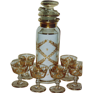 Heisey Glass Coctail shaker with a gold encrusted leaf pattern.
