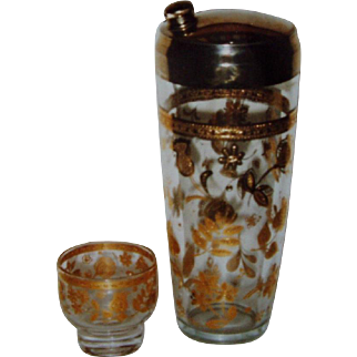 Gold embosed flowers on glass shaker with six low ball glasses