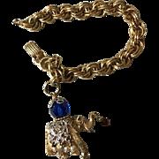 Napier Jeweled Elephant Charm Bracelet Book Piece