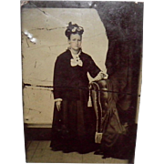 Antique Tintype Of a Young Woman Resting her hand On The Back Of a Chair Chair