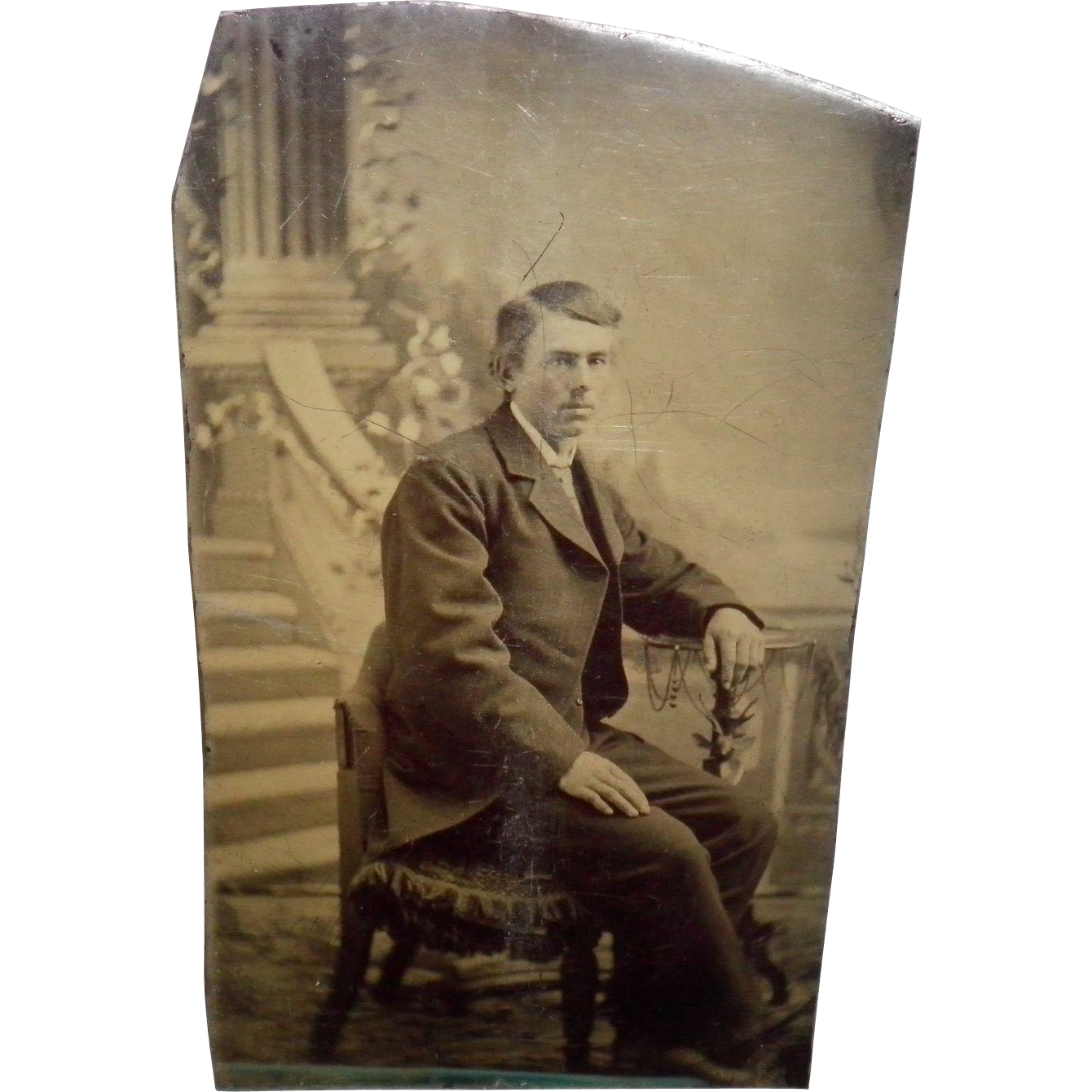 Antique Tintype Of a Man Stting In a Chair