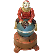 """1960's Reproduction Cast Iron """"Clown On Globe"""" Mechanical Bank"""