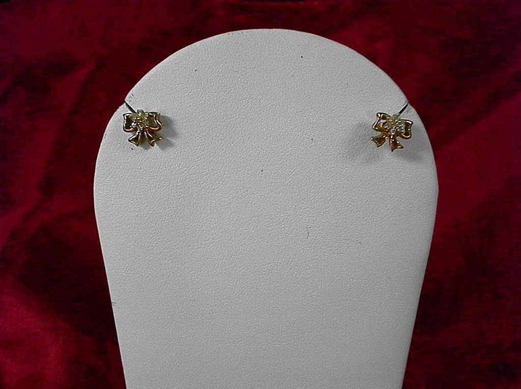 14 kt. Yellow gold Diamond Bow Earrings With Appraisal