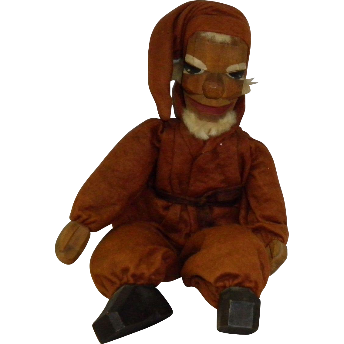 Folk Art Carved Man In A Sitting Position