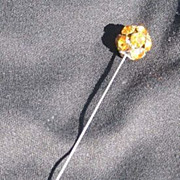 Vintage hatpin or stickpin, gold stones or rhinestones