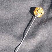Vintage hatpin or stickpin, gold stones or rhinestones